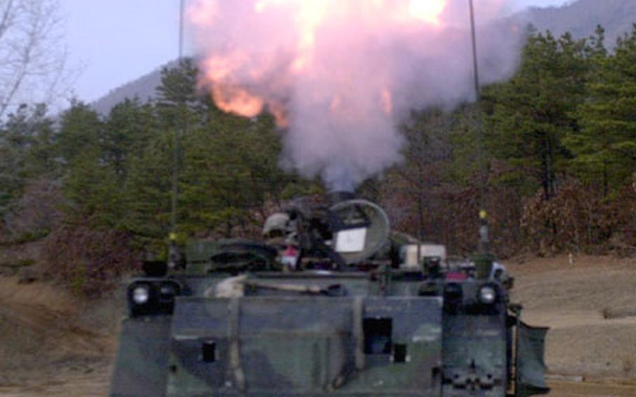 A Bradley Fighting Vehicle from the 2nd Infantry Division's 4th Battalion, 7th Cavalry fires a 120mm mortar round during a live fire exercise Thursday at Rodriguez Range.