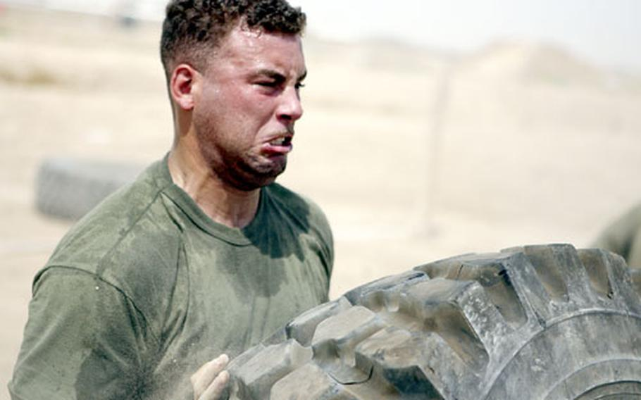 Lance Cpl. Jose Lopez, a 26-year-old Bronx, N.Y., native, uses determination in an effort to finish as the top contestant in a tire flip competition in August. The motor vehicle operator for Security Company, Combat Logistics Battalion 5, 1st Marine Logistics Group (Forward), finished second in the competition.