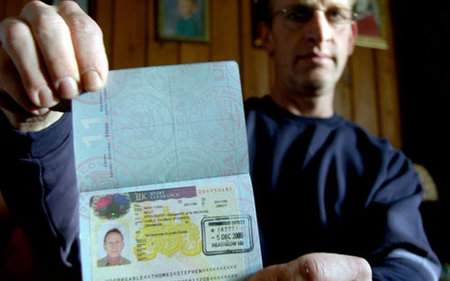 Tom Gable shows off his British visa days after he arrived in the United Kingdom to be reunited with his British wife. The former airman previously was denied the visa based on a few disparaging sentences he wrote about President Bush in a letter submitted as part of the application, but a judge reversed that decision.
