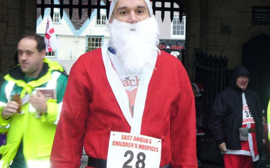 Wearing a Santa Claus outfit, Staff Sgt. Joshua Bauman poses for a photo before the East Anglia Children's Hospices charity run on Dec. 2.