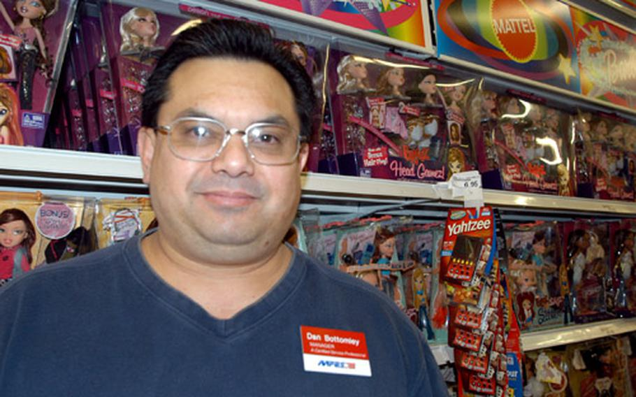 RAF Mildenhall BX manager Dan Bottomley says the popular Bratz dolls, behind him on the shelves, are selling well for the holidays.