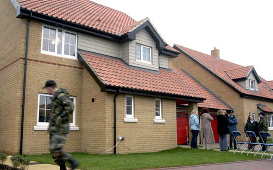 An airman walks past a three-bedroom home that was recently opened as part of the $209 million Liberty Housing Village project on RAF Lakenheath.