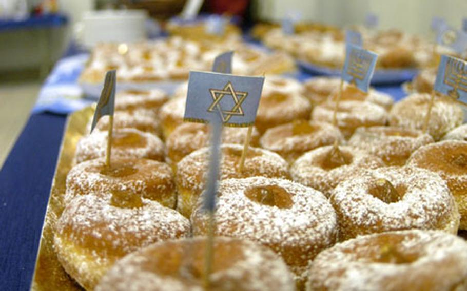 Jam-filled doughnuts, which must be cooked in oil, have become part of the Hanukkah celebration. Cooking foods in oil commemorates the miraculous burning of oil during the rededication of the Temple of Jerusalem. The Maccabees found only enough oil to burn for only one day, but the oil miraculously lasted for eight.