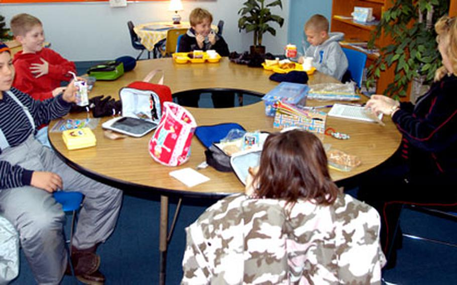 """Students at Sollars Elementary School eat lunch with counselor Leigh Fox during a recent """"Lunch Bunch."""" Clockwise, from left, are Jacob Whisel, Robert Pichner, Alex Clark, Brandon Johnson, Fox, and Autumn Newpher."""