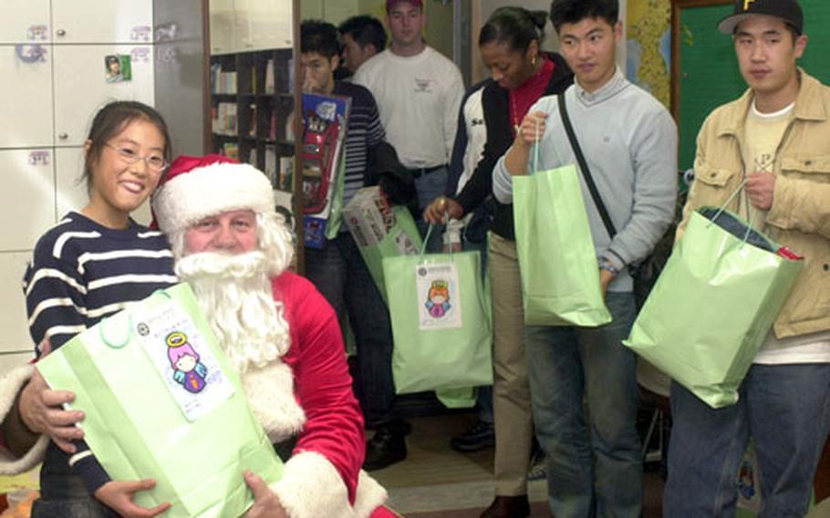 South Korean and U.S. servicemembers help Santa distribute gifts.