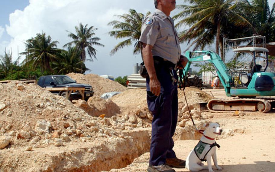 U.S. Department of Agriculture Wildlife Services dog handler Anthony Manibusan and dog Sawyer, at the groundbreaking ceremony for the new Working Dog Facility at Andersen Air Force Base, Guam.