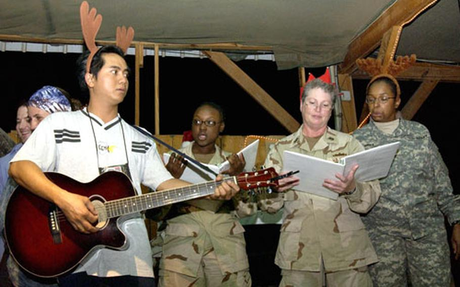 Christmas carolers brightened spirits at Djibouti's Camp Lemonier on Friday. Some 1,500 airmen, soldiers, sailors and Marines will be spending the holidays in the Horn of Africa.