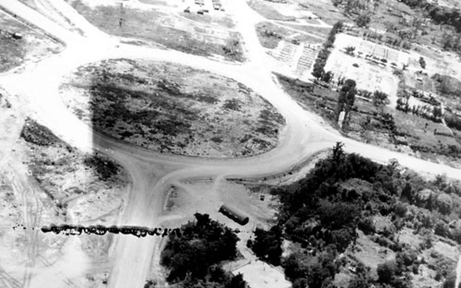 A traffic circle is constructed near what is now Kadena Air Base in 1945, when Okinawa was built up as a staging area for the invasion of the Japan mainland. Kadena Circle is now a thriving shopping district.