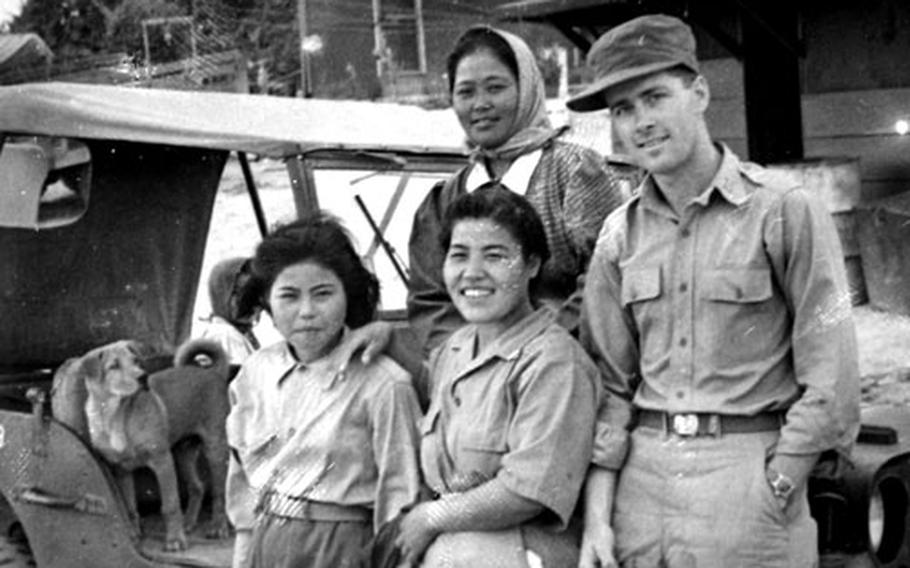 First Lt. Robert Rock with a group of Okinawan women in 1946 on Camp Koza, now Okinawa City.