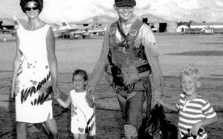 """Anne, Jenny, David and Jeff Johnson, in a family photo taken right before Capt. Guy """"David"""" Johnson went to Vietnam aboard the USS Kitty Hawk in 1965."""