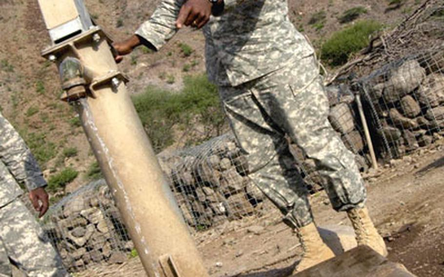 Staff Sgt. Richard Provitt examines a hand-pump water well near Dikhil, Djibouti recently. Provitt and other well drillers said they will suggest that a similar mechanical hand pump be used to replace a damaged, solar-powered well pump further west.