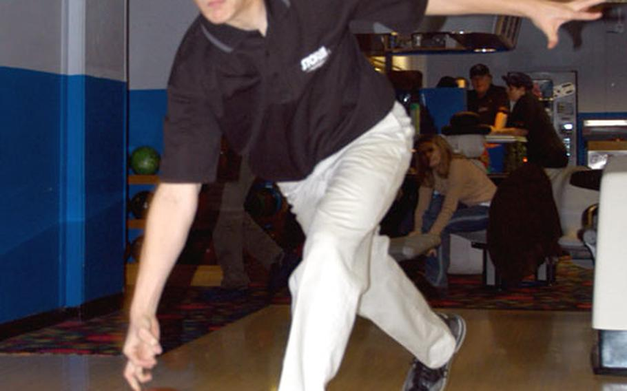 Lakenheath High School sophomore Dennis Patton shows off the roll that earned him a perfect 300 game.