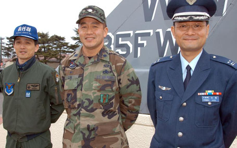Friends and classmates, from left, Lt. Col. Hiroshi Senba, Lt. Col. Stuart Lum and Lt. Col. Norifumi Kase share a special bond after graduating from the Japan Air Self-Defense Forces air and command staff college more than six years ago. Senba and Kase are assigned to the 3rd Wing at Misawa, while Lum falls under the 35th Fighter Wing as the 35th Aircraft Maintenance Squadron commander.
