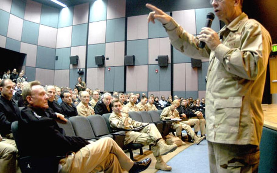Adm. Michael Mullen, chief of naval operations, talks to more than 400 officers and enlisted sailors in Naples, Italy, Thursday. Mullen and Master Chief Petty Officer of the Navy Joe Campa Jr. traveled to several sites in the Middle East and Africa, visiting with sailors.