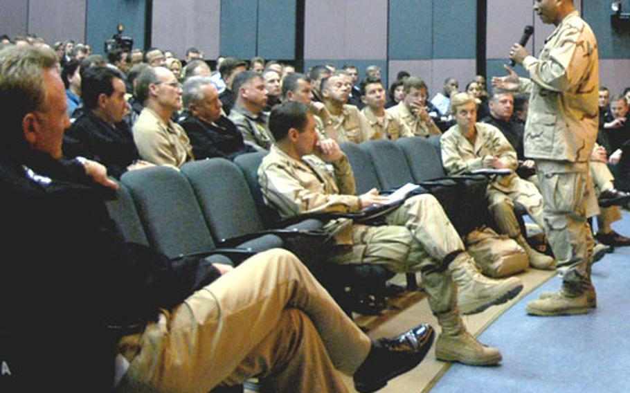 Master Chief Petty Officer of the Navy Joe Campa Jr., talks to officers and enlisted sailors during a stop in Naples, Italy.