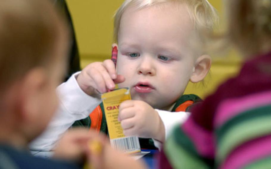 """Karter Aransmeyar enjoys taking crayons out and putting them back in their box during craft time at the HUGS playgroup held in the Pulaski Kid's Zone on Thursday. HUGS — """"Helping Us Grow Securely"""" — is a playgroup led by social workers from the New Parent Education and Support Program."""