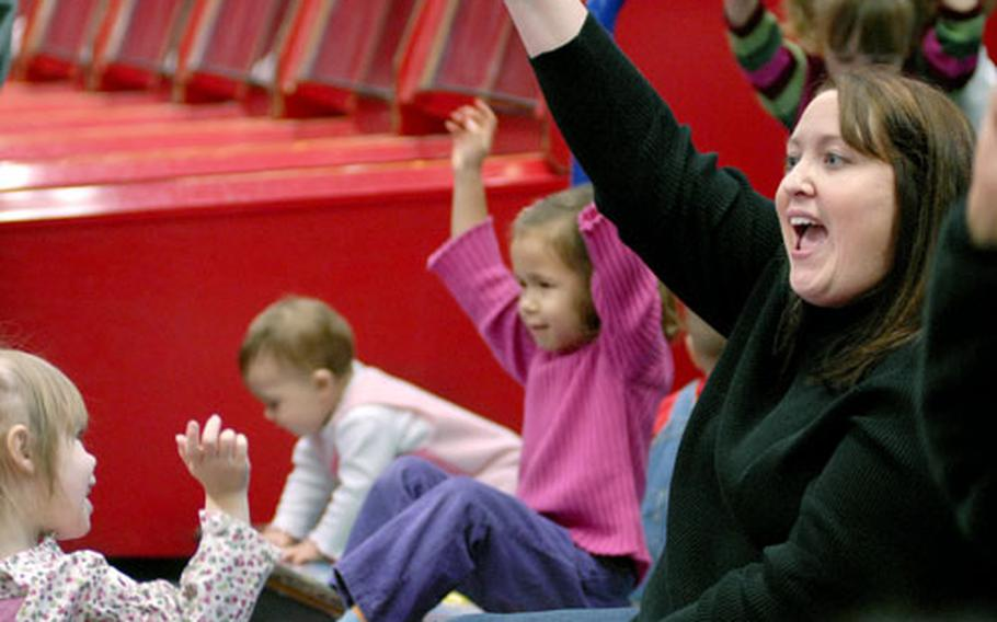 Jeanne Jahosky, a social worker from the New Parent Education and Support Program, leads singing time at the HUGS playgroup held in the Pulaski Kid's Zone Thursday.