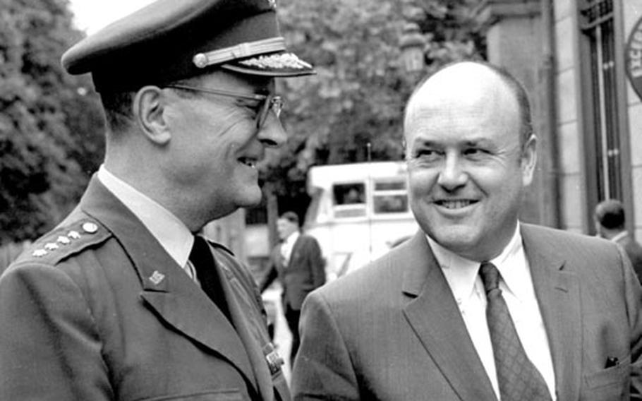 Secretary Laird talks with Gen. Earle Wheeler at Brussels, where the NATO Defense Planning Group was meeting.