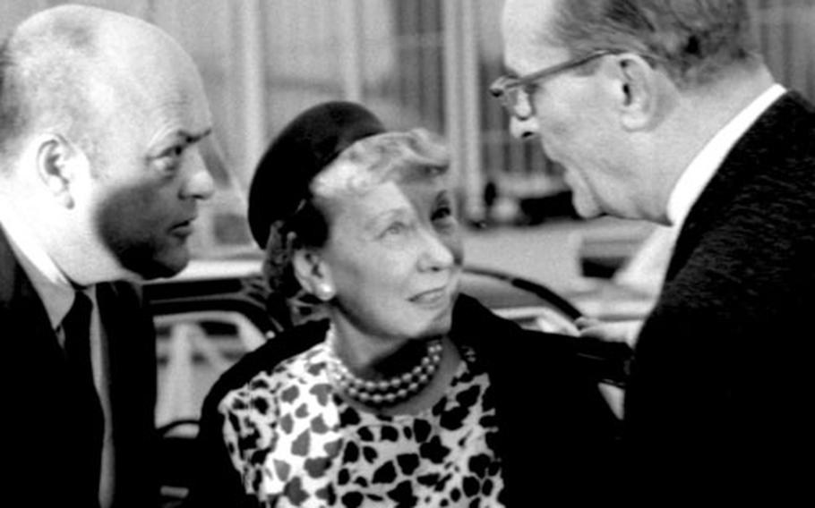 Secretary of Defense Melvin Laird, left, and Chairman of the Joint Chiefs of Staff Gen. Earle G. Wheeler with former first lady Mamie Eisenhower.