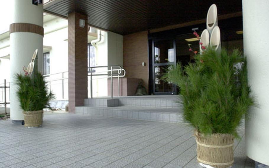 The kadomatsu, a gift from their Japanese counterparts, at the entrance to CFAO headquarters on Kadena.