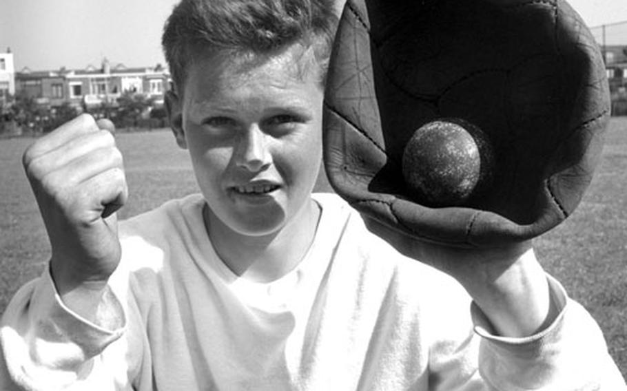 An old soccer ball serves as a catcher's mitt for a baseball player in the Netherlands in 1961.