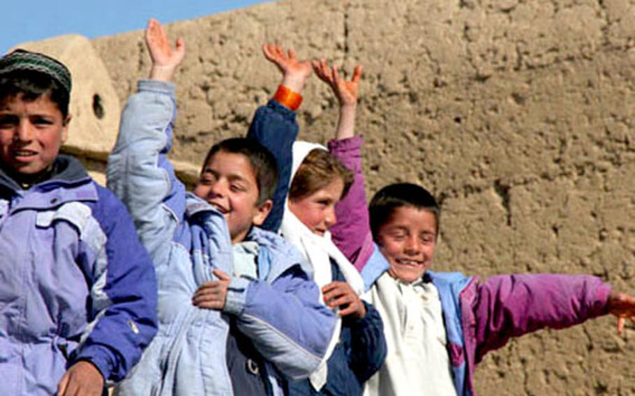 """Children at the Wardak Province Orphanage in remote Afghanistan where some of the 500 boxes worth of clothing was distributed. """"A lot of Afghanistan's beauty resides in the rugged geography, but it also fosters a great deal of isolantionism,"""" Lt. Howard Smith said. """"It was a great privilege to get out of Kabul adn visit this area where Americans almost never go."""""""