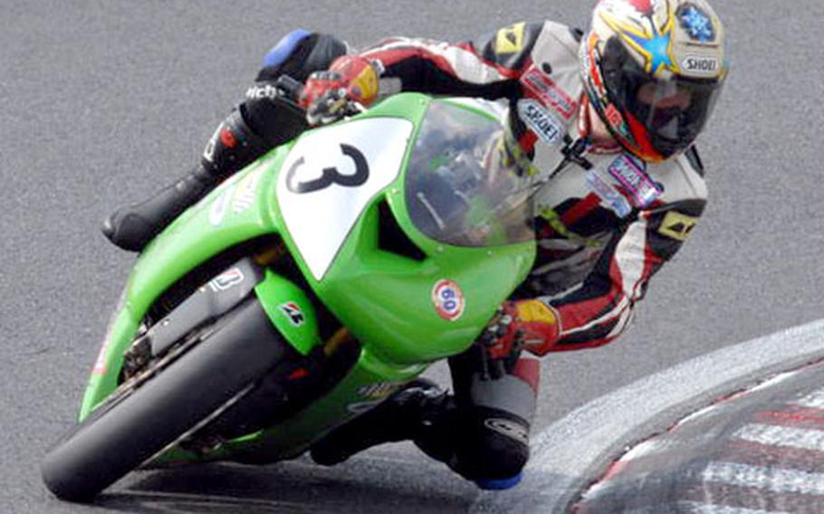 """Yokosuka civilian Craig Fajardin takes a high-speed turn at the Tsukuba racetrack last month in his first official race. At 39 years old, Fajardin decided to race in order to """"look his kids in the eye,"""" he said."""