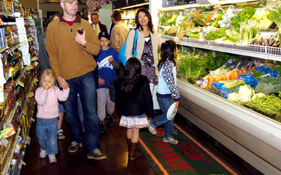 Shoppers check out the new commissary Saturday at Camp Zama.