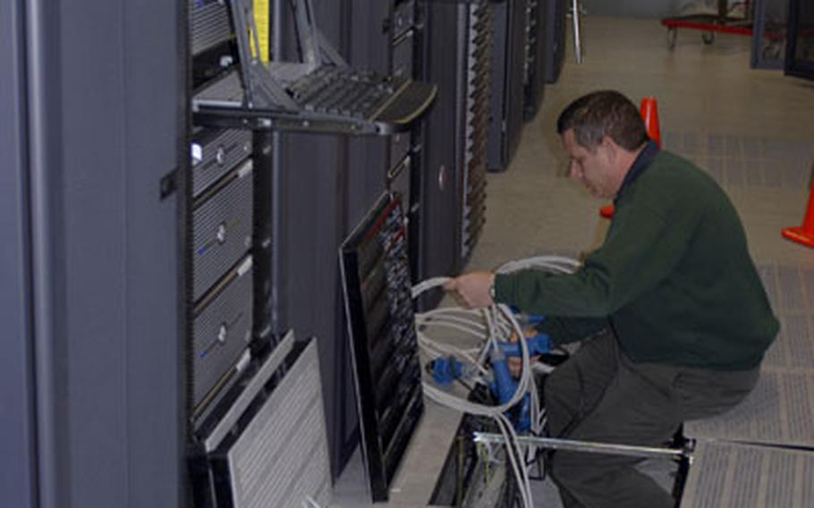 Grafenwöhr Area Processing Center chief Bill Kunz works on one of 150 servers at the new facility on Monday.