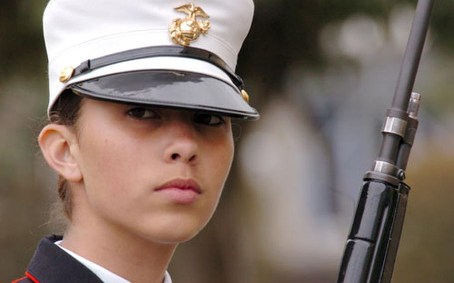 Cadet Gunnery Sgt. Jessica Doyle from Okinawa prepares for drills during the JROTC Far East Drill competition at Yokota Air Base, Japan, on Tuesday. The three-day competition brought together 165 cadets from Junior Reserve Officers Training Corps programs at high schools across the Pacific.