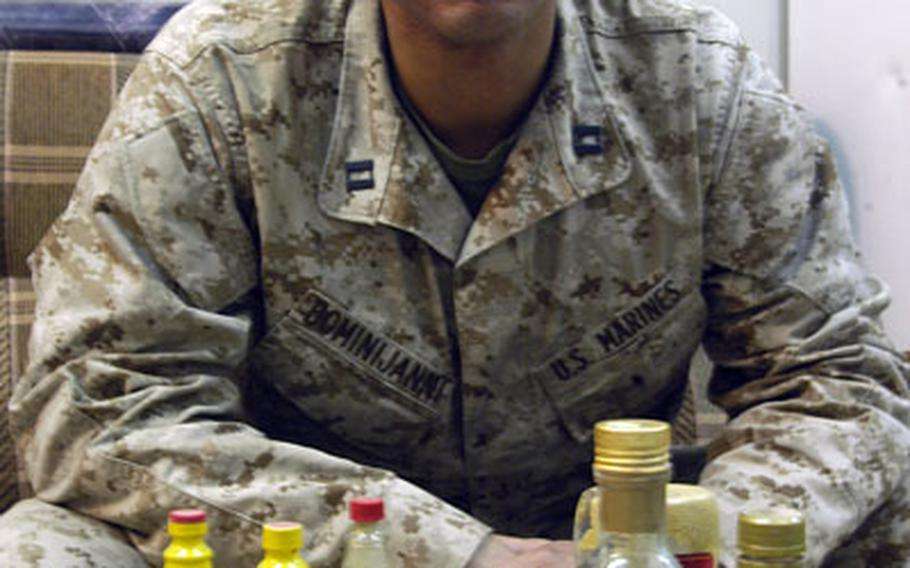 Marine Capt. Eric Dominijanni, 34, keeps a supply of sauces, spices and spreads that he says helps him stomach the food served at the chow hall food at Camp Fallujah, Iraq. As a culinary specialist, the grub doesn't always quite suit his palette. Dominijanni, the commanding officer of Company B, Assault Amphibious Battalion, now in Iraq, beat famed TV personality Bobby Flay in a televised contest last summer.