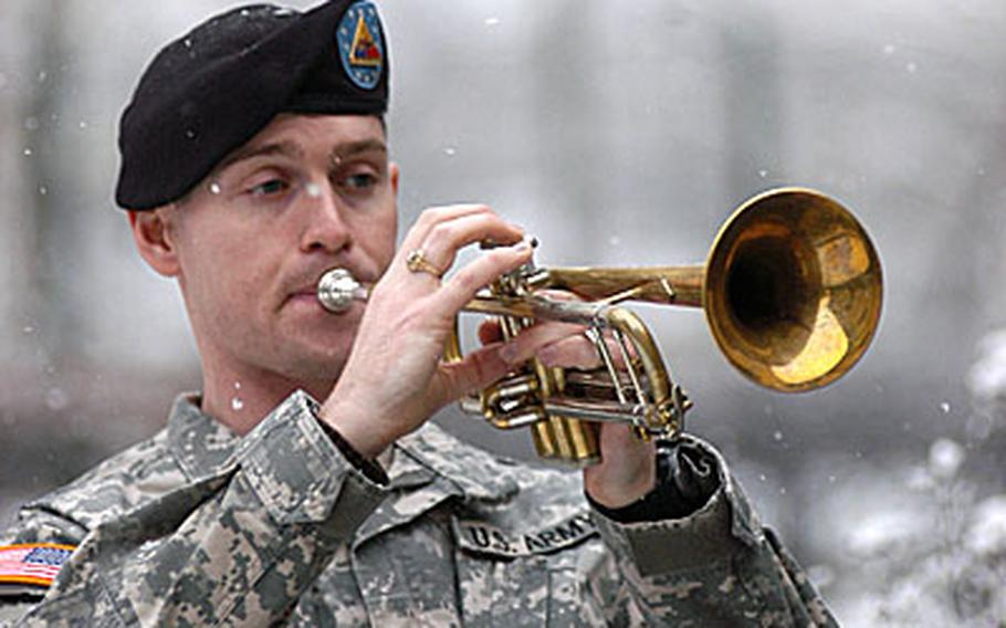 Army Spc. William A. Keele, of the 1st Armored Division band, plays taps at the memorial service Thursday for Spc. Alan E. McPeek.