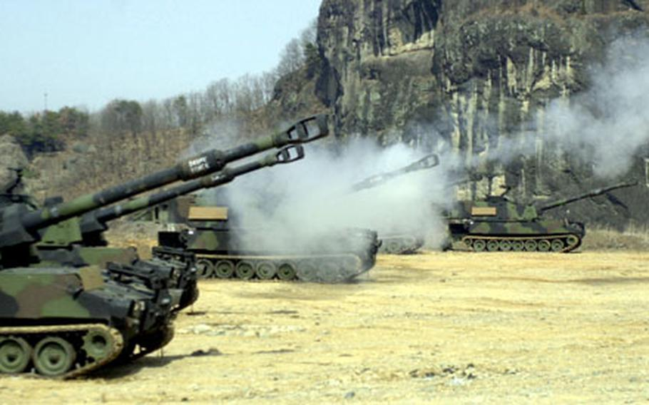 Soldiers fire their 155mm Paladin Howitzers at a firing point in Jeongok.