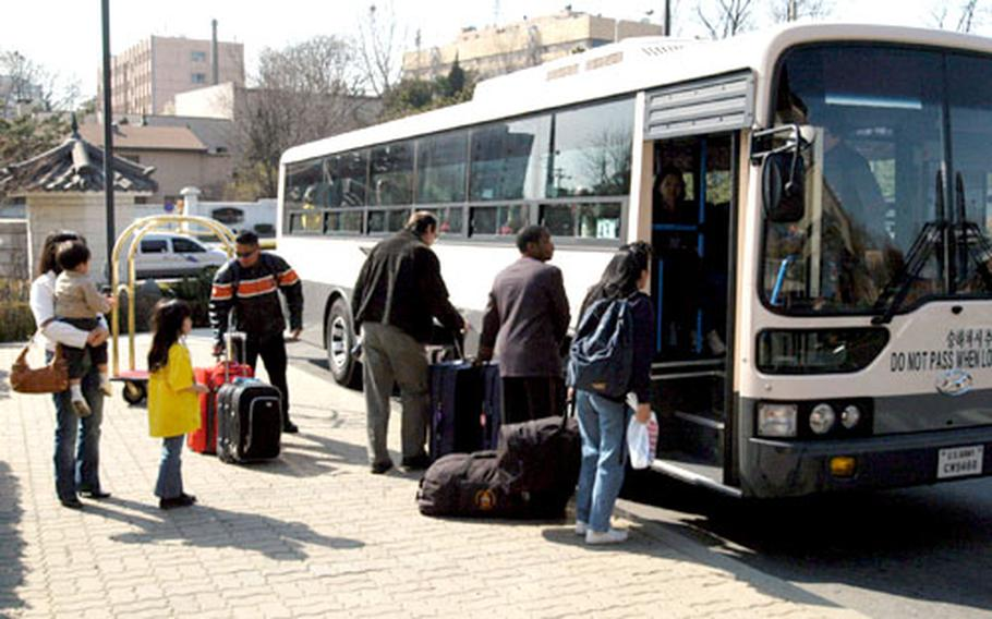Passengers bound for Incheon International Airport board the airport shuttle bus at the Dragon Hill Lodge.