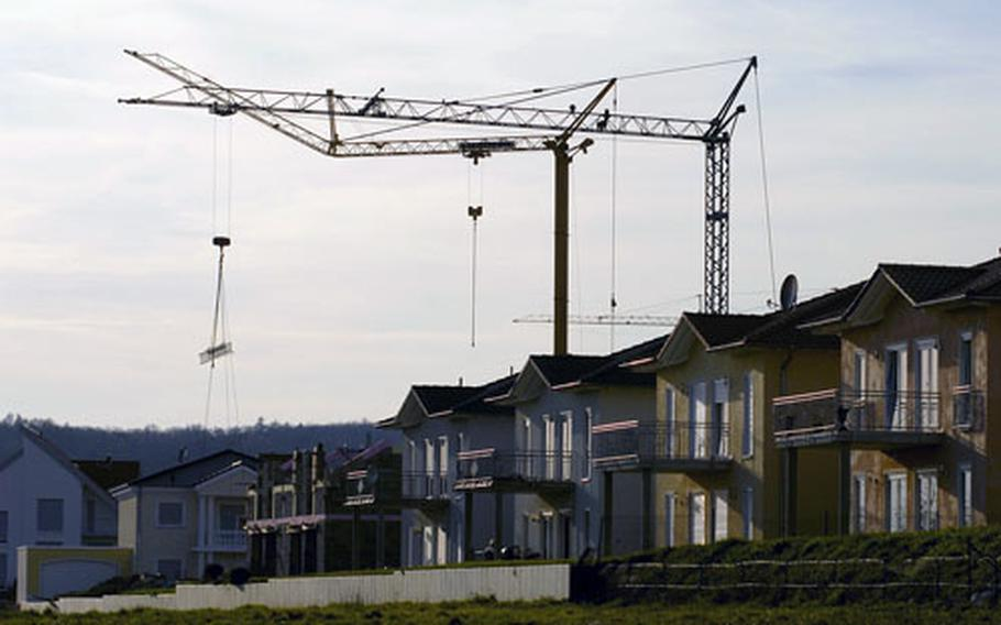 Cranes hovering over cities have become commonplace in the Kaiserslautern area such as these in the village of Machenbach near Ramstein Air Base. Ingolf Deubel, the minister of finance for Rheinland-Palatinate, stated during an interview with Stars and Stripes that there are plans to build as many as 1,800 homes to support Ramstein and Spangdahlem Air Base communities over the next few years, starting with a commitment to build 700.