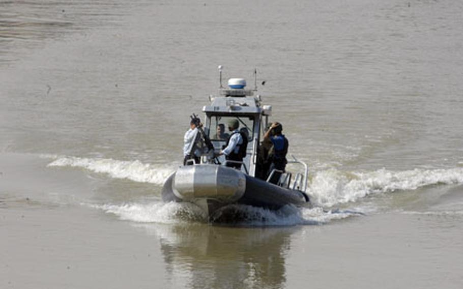 Iraqi policemen who make up the Baghdad River Patrol Station unit patrol the Tigris River in Baghdad. The unit monitors more than 35 miles of waterways in and around the Baghdad area.