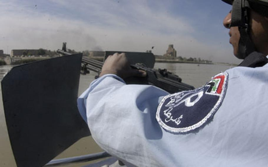 A young Iraqi police officer mans his .50-caliber machine gun while patrolling portions of the Tigris River in Baghdad on Tuesday.