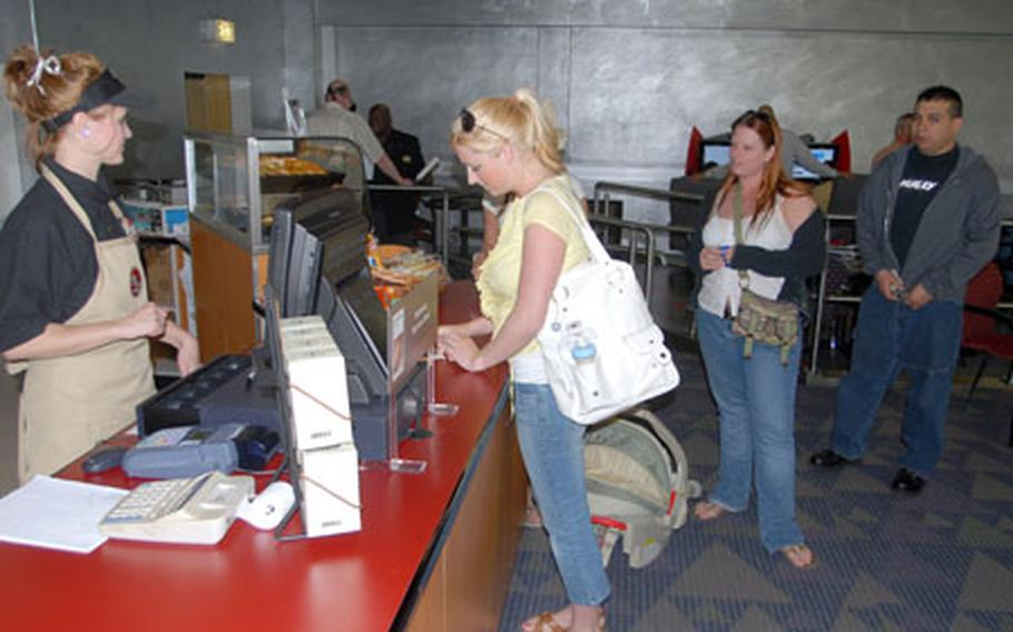 Customers order Starbucks coffee at Vilseck's new Java Cafe on Friday.