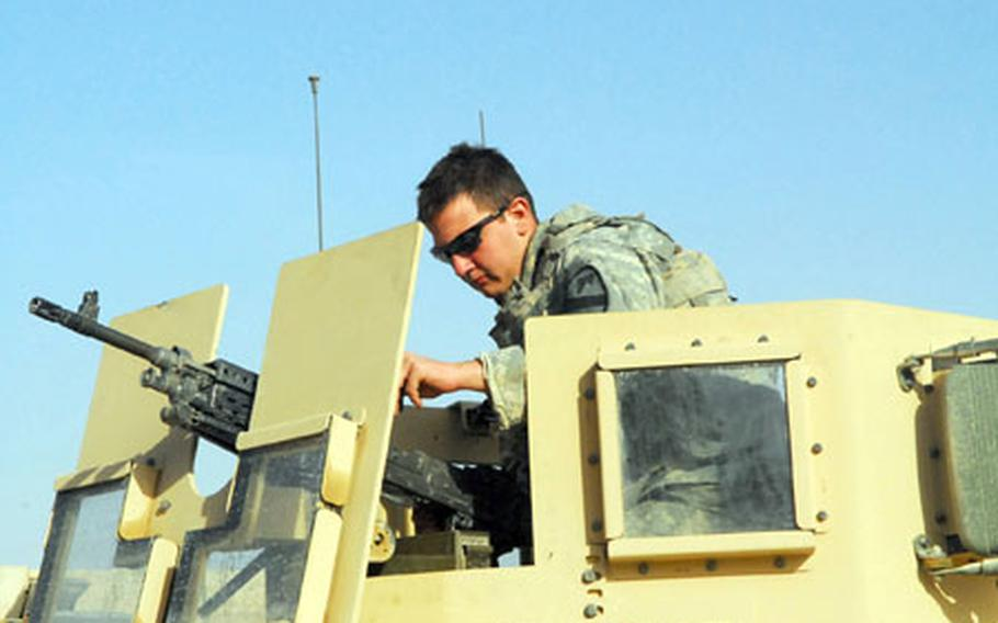 U.S. Army Spc. Michael Doke, 20, of Huffman, Texas, prepares to head out on a patrol in northern New Baghdad on Monday.