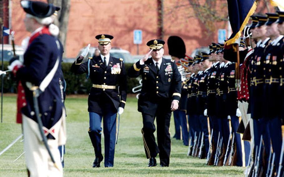 Gen. Peter Schoomaker, right, and Col. Robert Pricone inspecting the troop formation during the Army change of command ceremony Tuesday at Fort Meyer, Va. Gen. George W. Casey Jr. was named the 36th Chief of Staff at the Army during the event.