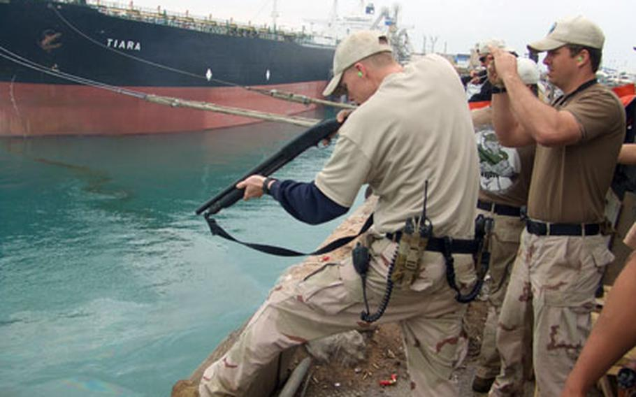Jeffrey Simpson, a master-at-arms, shoots an M-500 shotgun from the Iraqi oil terminal Basra during routine target training in February. More than 60 sailors from Mobile Security Squadron 7, Detachment 73 at U.S. Naval Base Guam were deployed to the northern Persian Gulf from September to March to help train Iraqi marines in protecting two offshore Iraqi oil platforms.