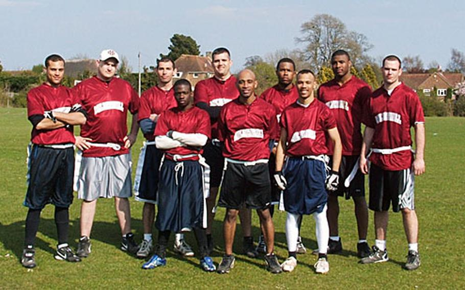 RAF Mildenhall-based airmen who play for the Mildenhall Mayhem pose for a picture. Front row, from left, are Tre Moorer, Stacy Cochran and Mike Dedousis. Back row, from left, are Brian Dillard, Jeff Butler, Jared Flores, Bob Black, Damion Lee, Byron Washington and Robert Trace.