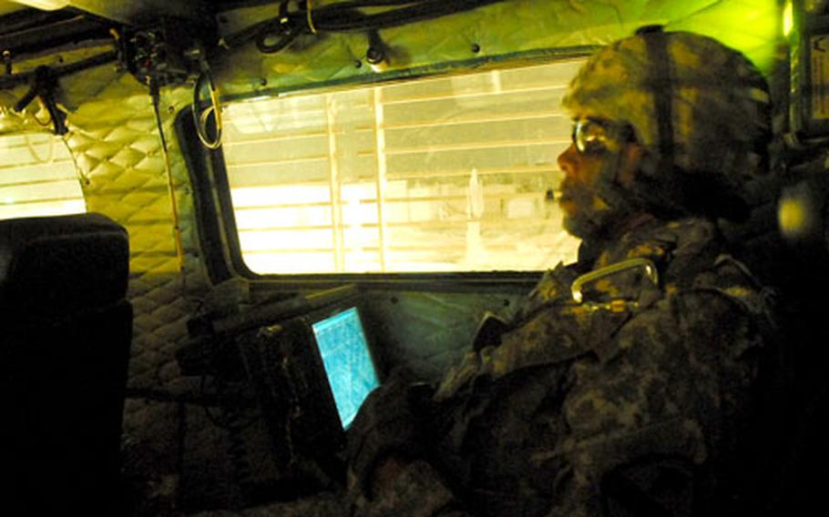 Sgt. 1st Class Augusta Creech, 37, of Wilson, N.C., commands a Buffalo mine clearing vehicle during a recent sweep in Baghdad.