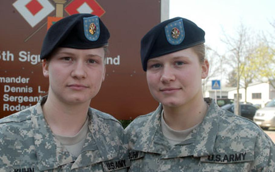 Julie, left, and Jennifer Kuhn, are identical twins and specialists with the 7th Signal Brigade in Mannheim, Germany. They were separated for the first time in their 21 years when they were assigned last year to different places in Iraq.