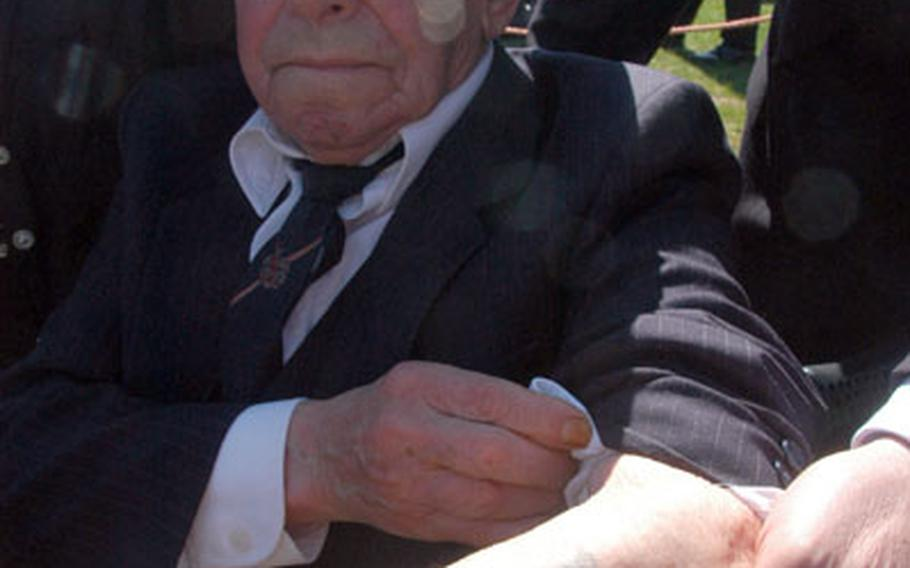Benjamin Gelhorn shows a tattoo of the number 142906, which was burned into his arm during World War II at the concentration camp in Auschwitz, Poland. Gelhorn was attending a ceremony for the placing of gravestones at Stuttgart Army Airfield in Germany, where the remains of 34 Holocaust victims were found in September 2005.