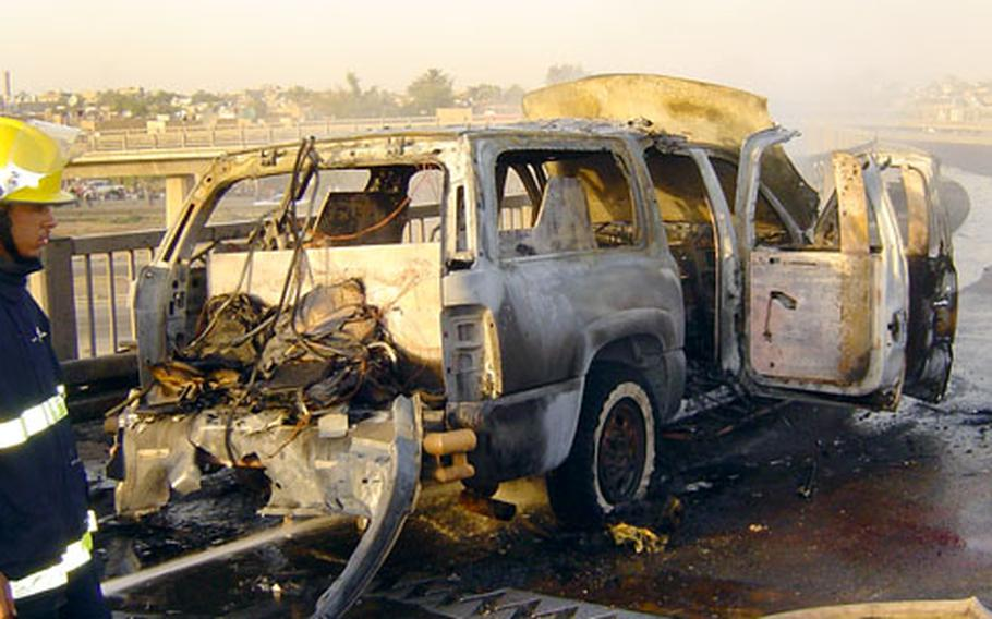 A private contractors' vehicle was hit by a roadside bomb, killing three men in May 2005.