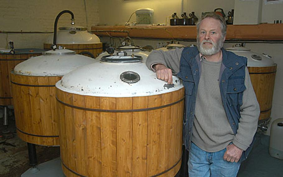 Dennis Cooper, owner of The Brandon Brewery, stands inside his one-room brewery.