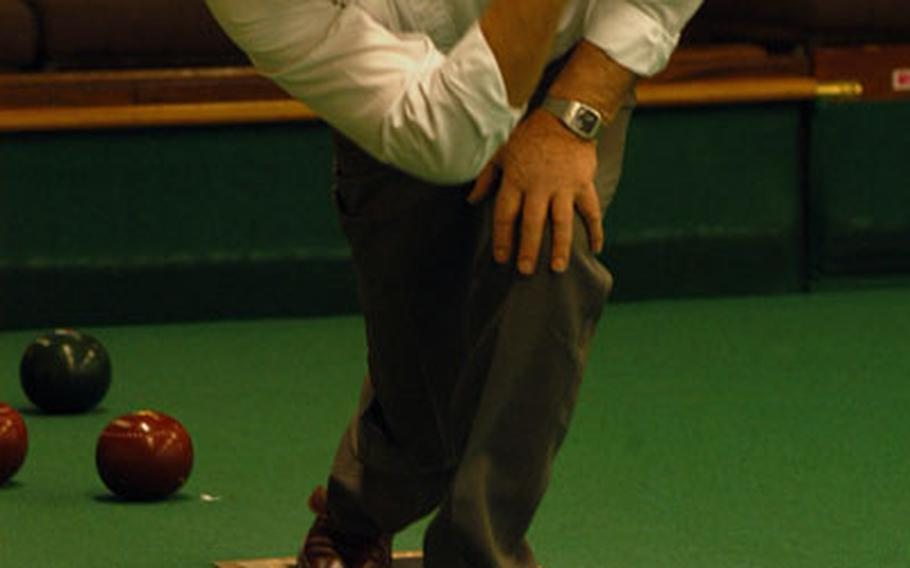 Ely Bowls Club member Peter Czarnobaj releases a wood in a recent league match at the club's indoor facility. Play at the club moves outdoor for matches starting in May.