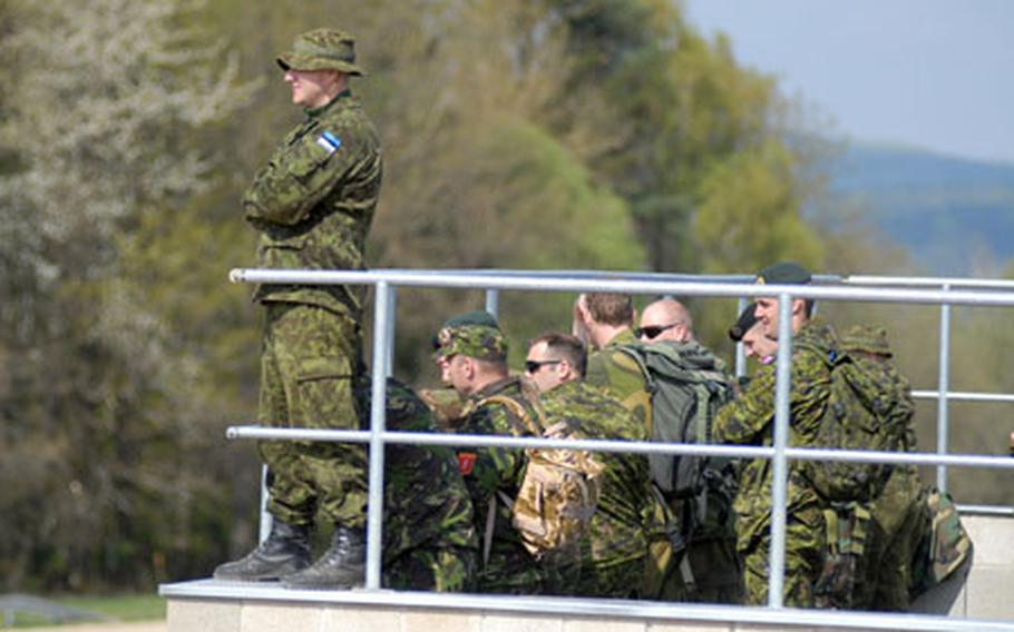 NATO troops watch as U.S. soldiers from the 1st Battalion, 4th Infantry Regiment conduct counter-roadside bomb training at Hohenfels' Joint Multinational Readiness Center on Friday.