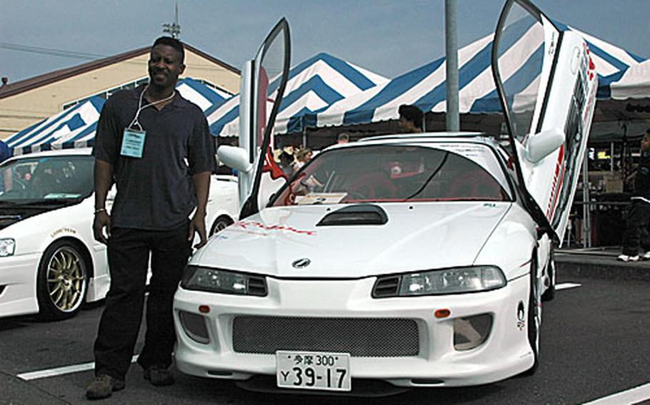 Master Sgt. Myron Potter and his scissor-doored 1992 Honda Prelude. Potted explained that he has spent nearly five years working on this, his first show car.